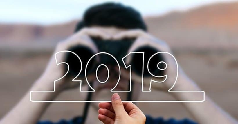 person looking ahead with binoculars towards the year 2019